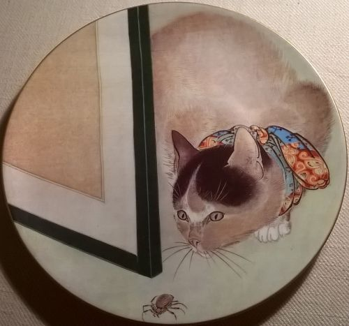 Cat and spider porcelain plate