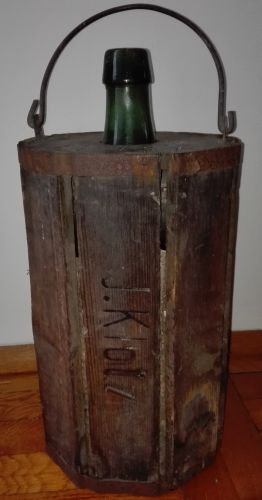 Antique bottle in a wooden case
